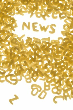 word NEWS made of pastas letters, white background, vertical photo Stock Photo - 5588474