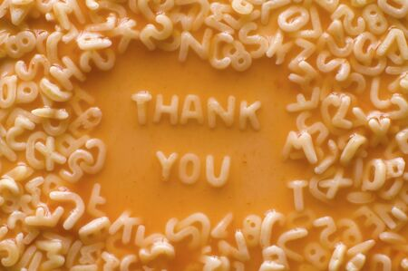 greet card: thank you made of food letters in ketchup soup Stock Photo