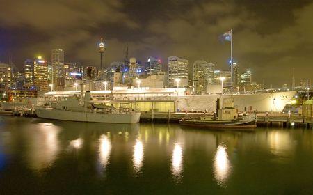 a battleship: Battleship HMAS Vampire at the Maritime museum in Darling Harbour, Sydney, night photo Stock Photo