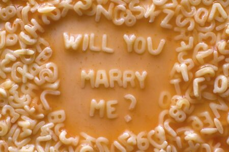 text WILL YOU MARRY ME made of pastries letters photo