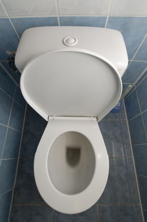 vertical photo of a white clean toilet, tiles on floor and walls Stock Photo - 6042524