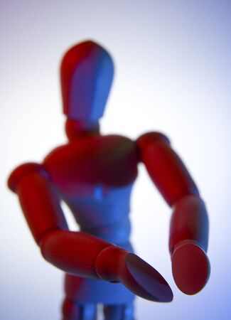 wooden figurine in a conceptual pose - pointing arms at something - can be a logo or a product photo
