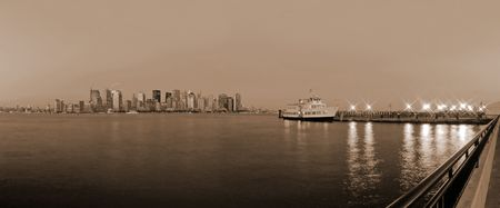 sepia photo of Manhattan and a ferry boat photo
