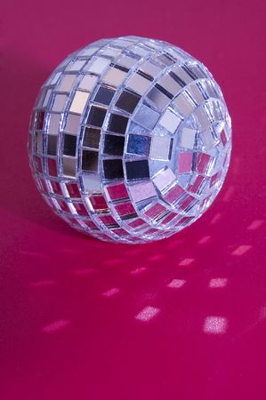 music disco ball on pink background, light reflections Stock Photo - 6769713