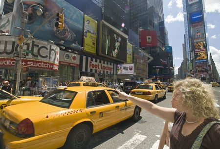 AUGUST 9 2008 - TIME SQUARE, MANHATTAN, NEW YORK, USA - two women travellers looking for something, taxi cabs and advertisment boards in background Stock Photo - 6896382