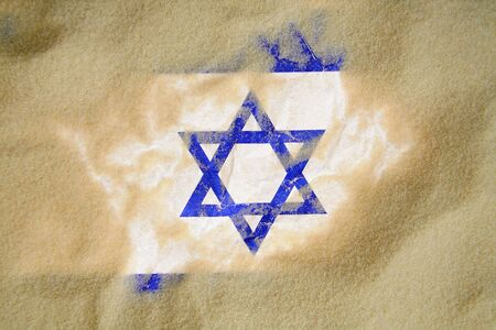 Israel flag buried in sand, conflict theme photo