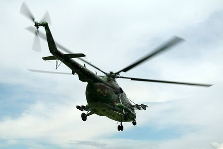 flying military helicopter MIL-MI silhouette Stock Photo