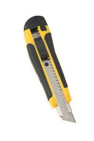 yelowblack utility knife isolated on white background, vertical photo photo