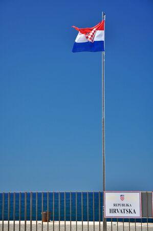 republika: Croatian flag and sign REPUBLIKA HRVATSKA, clear blue sky Stock Photo