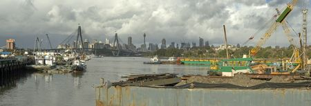 anzac bridge: panorama photo of industrial Sydney near Anzac bridge, Centepoint Tower and city CBD in distance