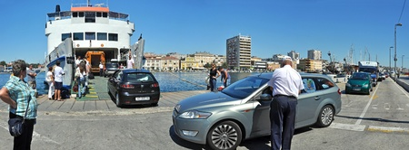 ferryboat: cars loading to Jadrolinija ship in town Zadar, Croatia. panoramic composition Editorial