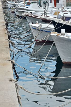 anchoring: several small boats anchoring in a port