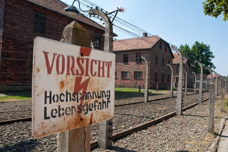 electric wired fence warning sign in concentration camp Auschwitz in city Oswiencim, Poland