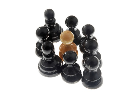 chess pieces arranged as a racism scene