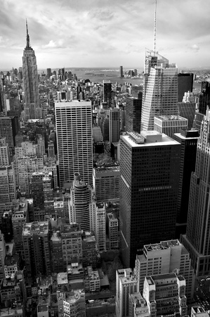 vertical black and white photo of New Yorks Manhattan, Empire State Building in background