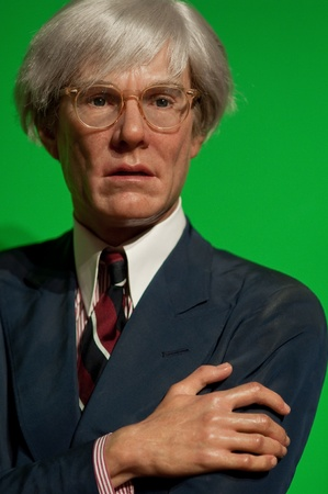 andy: portrait of Andy Warhol on green backgroud. wax figure at Madame Tussauds in New York