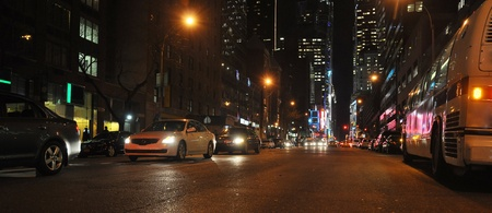 streetlight: night urban panorama with light traffic, photo taken in New York Editorial