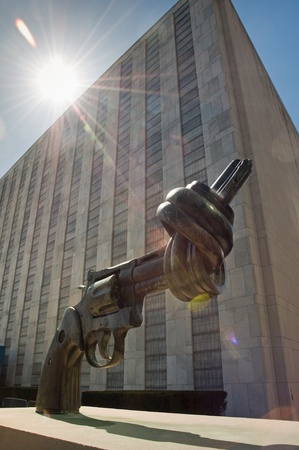 un: Gun tied in a knot in front of the UN headquarters in New York, USA Editorial