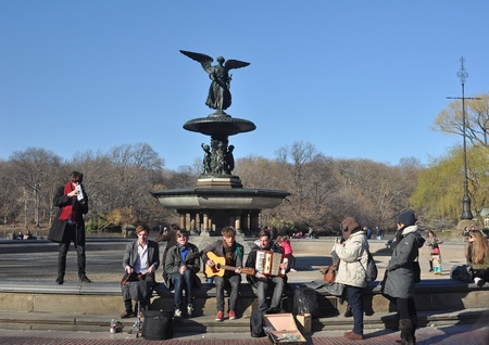 bethesda: 26. MARCH 2011 - NEW YORK CITY, USA - young music band performing at Bethesda Fountain in Central Park, Manhattan, New York City, USA. Photo taken on 26. March 2011.