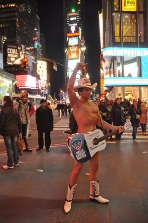 27. MARCH 2011 - TIME SQUARE, MANHATTAN, NEW YORK, USA - The Naked Cowboy performing during night at Time Square of Manhattan, New York, USA. Photo taken on 27. March 2011.