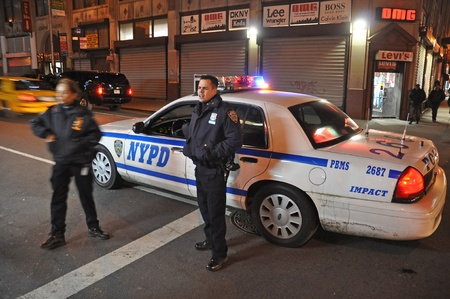 27. MARCH 2011 - NEW YORK CITY, USA - police officers standing in front of their car (NYPD) in Manhattan, New York, USA. Photo taken on 27. March 2011.