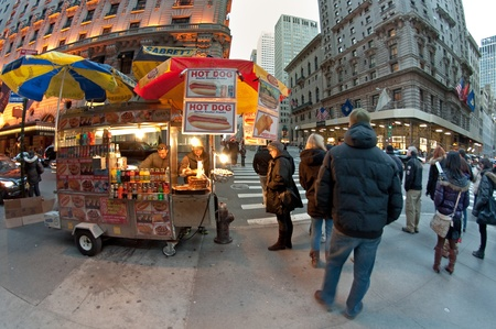 27. MARCH 2011 - MANHATTAN, NEW YORK CITY, USA - street scene of typical hot dog cart in Manhattan, NYC, USA. Photo taken on 27. March 2011.