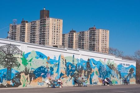 29. MARCH 2011 - CONEY ISLAND, BROOKLYN, NEW YORK, USA - people sitting in front of New York Aquarium graffiti wall on Coney Island in Brooklyn. Photo taken on 29 march 2011.