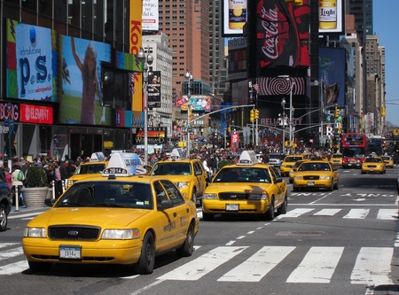 yellow NYC taxis on Times Square, New York City.