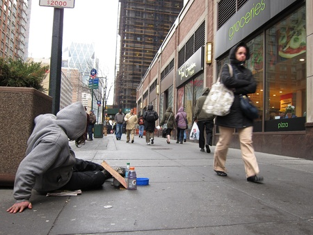 humbled: homeless man begging for money in front of a groceries store in New York City Editorial