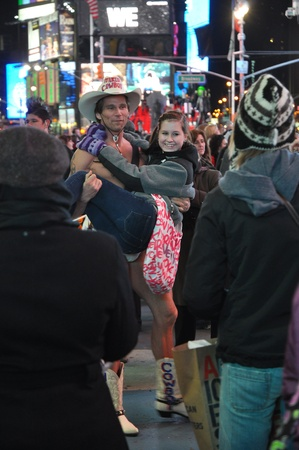 27. MARCH 2011 - NEW YORK, USA - Naked Cowboy holding a young girl on Times Square, Manhattan, New York City. Photo taken on 27 march 2011. Stock Photo - 11459447