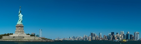 statue of liberty: The Statue of Liberty on Liberty Island, New York City panorama photo Stock Photo