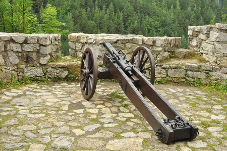 gunnery: ancient cannon at a castle wall, photo taken on Strecno castle near Zilina, Slovakia.