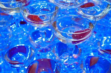 champagne glasses detail photo, shallow depth of field, blue artificial light photo