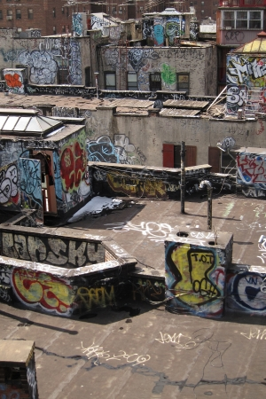 anarchy: damaged rooftops with graffiti artwork in New York, USA.