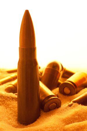 iraq war: different ammunition scatter in sand, detail vertical photo