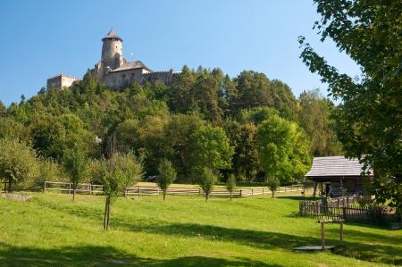 historic wooden hut under Stara Lubovna castle in Slovakia.