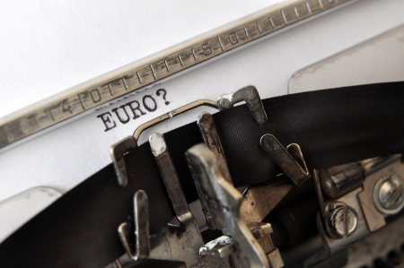 scepticism: word EURO with a question mark written on an old typewriter