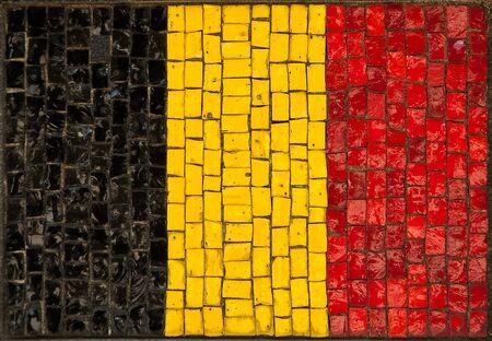 made in belgium: old Belgium flag made as window-pane. detail photo.