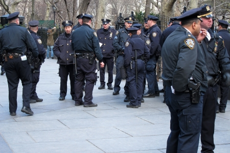 24. MARCH 2011 - NEW YORK CITY, USA - police officers in a street of New York City, USA. Photo taken on 24 march 2011. Stock Photo - 15102926