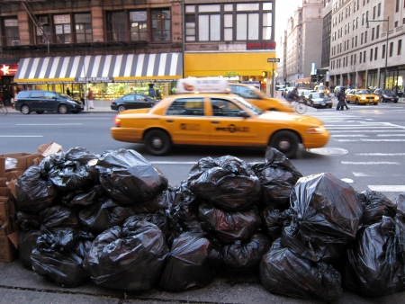 28. MARCH 2011 - MANHATTAN, NEW YORK, USA - black plastic bags of trash laing on street. Photo taken in New York City, on 28 march 2011. Editorial