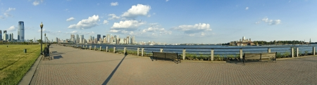 ellis: panorama photo of Liberty State Park in New Jersey  Ellis Island, downtown Manhattan and small Statue of Liberty visible
