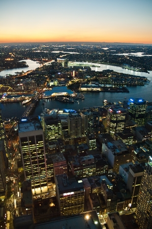 aerial view of night Sydney cityscape  Darling Harbour and Anzac bridge visible  vertical photo