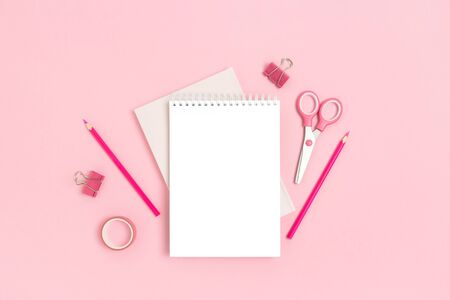 Blank notepad template with stationery on a pink pastel background. Monochrome back to school concept with copy space. Imagens