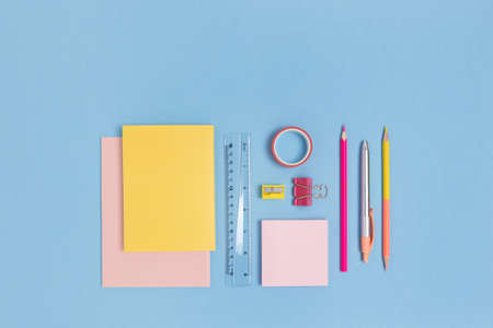 Group of colorful school supplies on a blue pastel background. Stationery creative concept. 版權商用圖片