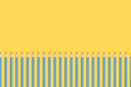 Blue pencils border frame on a yellow background. Back to school concept with copy space. Reklamní fotografie