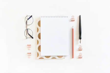 Spiral notepad mockup with glasses and stationery on white background