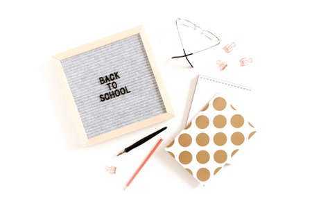 Quote Back to school. Flatlay of letterboard, glasses, stationery, notepads on white desk