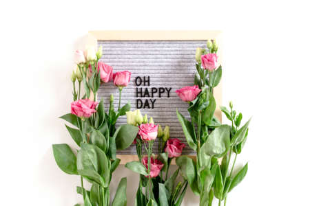 Quote Oh happy day. Flatlay with letter .board and eustoma flowers on white background 版權商用圖片