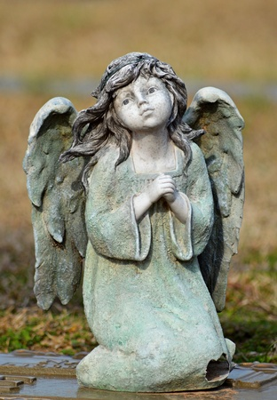 angel cemetery: a small statue of an angel at a cemetery Stock Photo