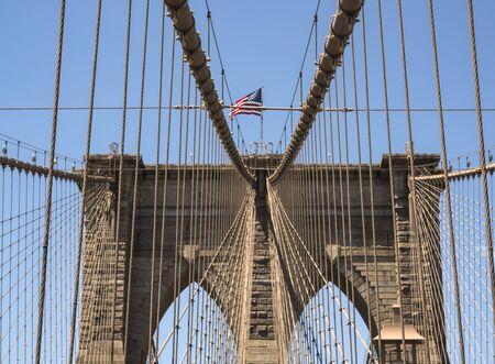 Brooklyn Bridge Tower with USA flag - Brooklyn, New York, NY, United States of America, USA Stock Photo